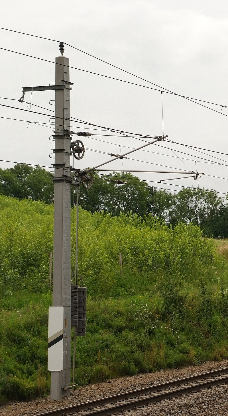 Catenary in Austria with overhead contact wire, carrying cable and insulators