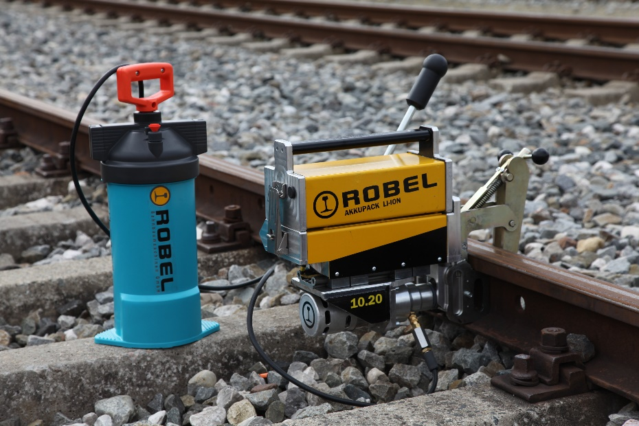 Rail drilling machine with electric drive and coolant supply
